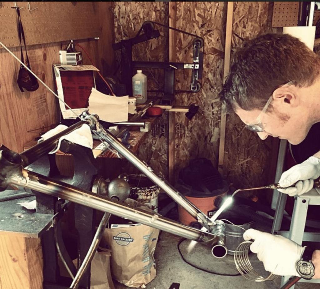 Chris welding bike frame