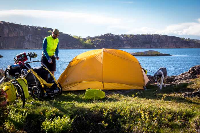This guide helps you decide how to pick the best tent when you go camping with dogs + we highlight some of our recommendations.