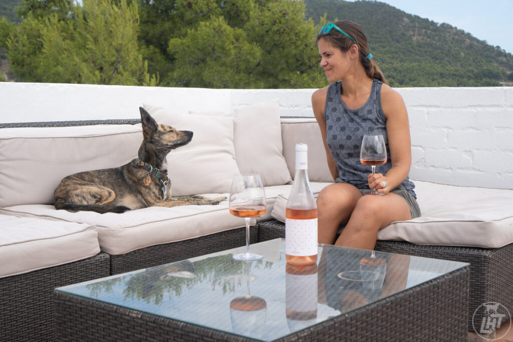 Sipping wine on the rooftop deck of our luxury glamping rental.