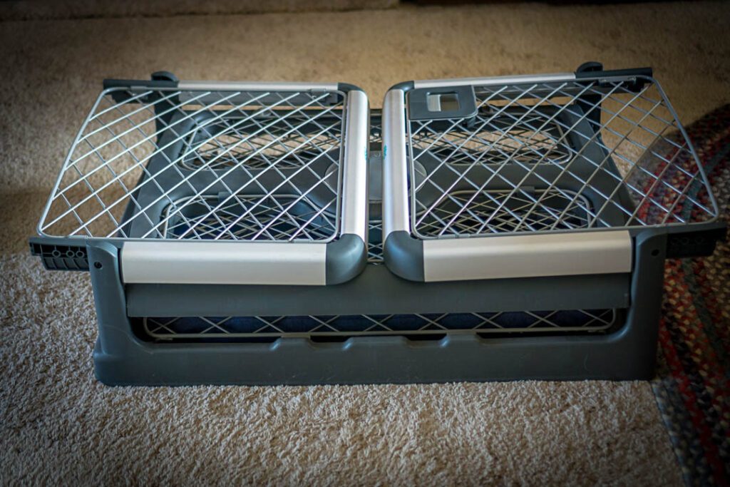 The Diggs Revol Dog Crate folds down flat and includes wheels and handles for easy transportation.